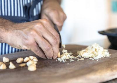 Chef Hiram dicing macademia nuts